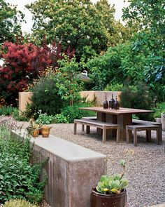 This outdoor dining room is edged, appropriately enough, with culinary herbs and fruit trees, including a fig and persimmon.
