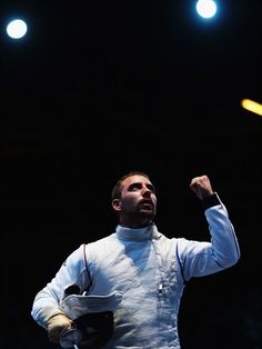 Victor Sintes of France celebrates fencing win#
