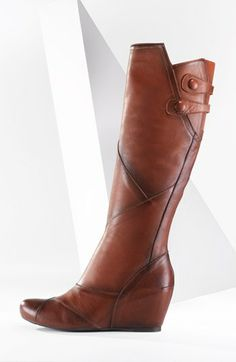 Curvy seams swirl around the shaft of a covered-wedge boot tipped with twin, covered buttons.  #blackfriday #sale - only $149!