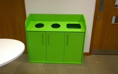 Three door bespoke recycling cupboard in green.