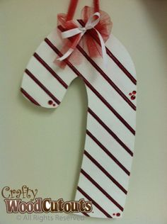 Hanging Candy Cane December Unfinished Wood Craft. This craft is about 10″ wide by 18″ tall and costs $13.99.