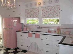 Pink kitchen!  And love the black and white floor.