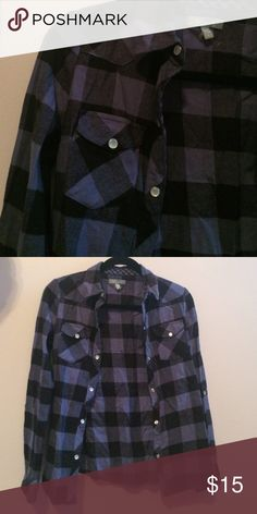 Thick Blue/Purple Flannel This Flannel will keep you warm ,while making you look cool. Casual, Comfortable. Never been worn. Delia's Tops Button Down Shirts