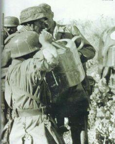 Thirsty Fallschirmjager of the 3rd Fallschirmjager Regiment, drinking water. Kreta, 20. May. 1941.