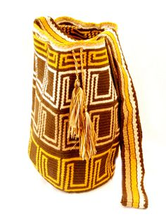 Golden Brown Wayuu Mochila Artisan crafted Wayuu mochila, brown background with golden yellow geometric design, matching color tassels  By Sea Salt, Colombia  $120