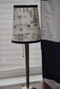 Lovely nursery with a plane theme.  Pinning because I love the plane fabric and want to make a skirt out of it.