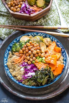 Roasted Vegetable Buddha Bowls make the perfect light & healthy meal. Butternut squash, broccoli, brussels sprouts & chickpeas on quinoa with best avocado