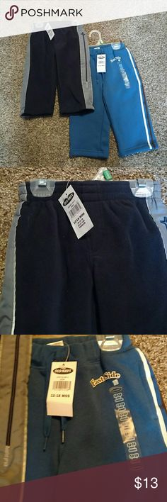 NWT Set of 2 Old Navy Baby Boy Sweats Set of 2 Old Navy sweat pants Both new with tags  One pair is blue with a white and brown stripe that goes down the side of the pant legs One pair is Navy blue with a gray stripe that goes down the side of the pant legs Old Navy Bottoms Sweatpants & Joggers