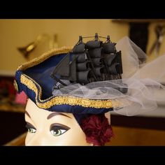 Handmade OOAK pirates of the Caribbean tricorn hat Handmade from buckram and millinery wire. One of a kind. I made this for the POTC 4 premier in Los Angeles. The black ship is real vintage and represents the Black Pearl. The light gray tulle represents the fog that always follows it. All fabric is 100% silk.  Wig clip underneath attaches to your hair. Also there are ties to tie behind head. Each side are face framing dangles inspired by Jack Sparrows many trinkets. Glass beads, wood skulls…