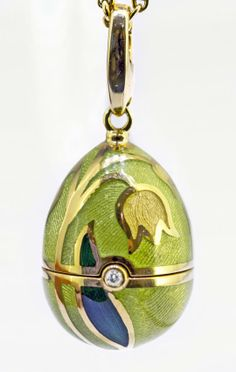 Faberge art nouveau egg pendant art nouveau flowers gold art faberg egg pendant and necklace stamped faberg 750 and numbered the egg decorated with flowers hinged with a round diamond opening to a bird on a aloadofball Choice Image