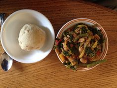 Cleopatra Jones' akpele (corn and cassava dough dumpling) and stew on July 24, 2014.