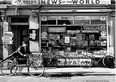 Walsh's newsagents Radcliffe  Walsh's newsagents shop, on Water Street, Radcliffe, with its colourful display of 1960's cigarette and tobacco advertising. Bicycles left by the newsboys out on their deliveries.