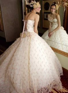 ballgown wedding dress with net-like lace skirt