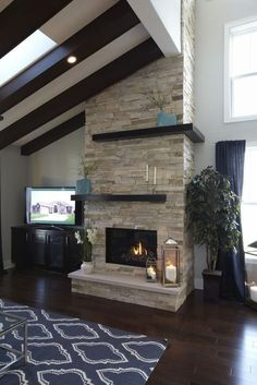 Gray Stacked Stone Fireplace With Black Hearth Design Ideas