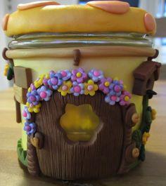 polymer clay house on a jar