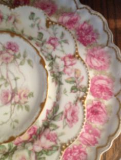 Oh so pretty! Antique Haviland Limoges plates with roses. So many roses, so little time!