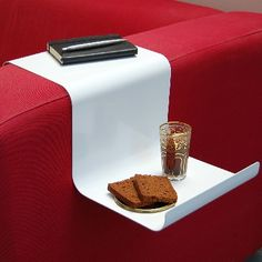 Tired of knocking over drinks and sandwiches you keep putting on your sofa's armrest? Never lose a bacon and peanut butter sandwich to a dirty floor again with the SofaHanger, a stylish tray designed to hang right on your couch's arm.