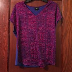 Fun and comfortable top Super practical staple item for your closet. This works for business, going out, or everyday. Silky in the front, cotton in the back. Mossimo Supply Co Tops Blouses
