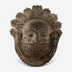 A COPPER ALLOY MASK OF A DEITY, South Canara, 19th Century CE, Live Auction, Mumbai, December 17, 2014