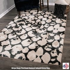 nfluenced by modern art, the globally inspired Animal Area Rug in Inkwell from Orian Rugs features an exotic pattern cast in a neutral beige and navy blue color palette...