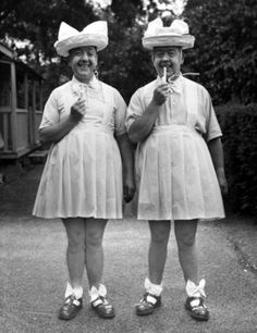 The 'lovely' Primwaddle Twins, Mort and Harvey, circa 1929. Their mother, Discordia's husband left after seeing the homely pair. Embittered to men, left alone to raise boys, she insisted they were girls, and got away with it home-schooling them for...