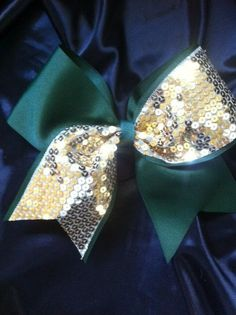 Gold Sparkle Sequin Tick Tock Bow on by AnnieBowBannieBows on Etsy, $10.00