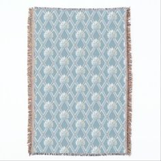 A vintage dusty gray blue wallpaper pattern throw pillow with an old fashioned beige and cream feather fans against a classic diamond lattice and blue background.