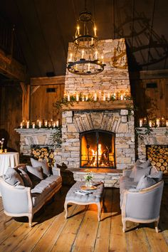 Wedding lounge by fireplace // BRIDES Feature: One Couple's Elegant Spring Wedding in Highlands, North Carolina