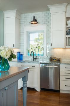 House of Turquoise: Caldwell and Johnson. Beautiful pale blue tile work in modern farmhouse style home.