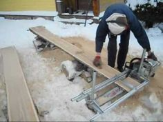 Milling a small oak log in winter.Granberg Alaskan MK III chainsaw mill with Stihl 088. chainsaw. Using my self design guide rail system with unmodified alum...
