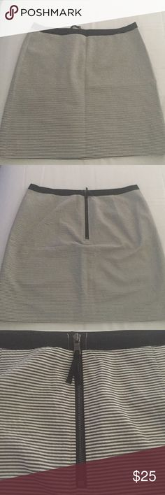 A-Line striped Loft Skirt This skirt is a black and white stripe with a very slight a-line, it falls just above the knee, and has a cute black exposed zipper in the back, with a black grosgrain waistline. Very cute. EUC, worn two or three times. LOFT Skirts
