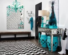 Layers of aquamarine accessories make this entryway cheerful and chic.