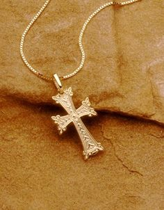 """Boasting a decorative motif, the Armenian cross symbolizes life. Our Armenian cross pendant is available in 18K or 14K white or yellow gold and three sizes (measurements without bail): large (3/4"""" x 1 1/4"""" or 20mm x 34mm), medium (5/8"""" x 1 1/8"""" or 16mm x 28mm), small (1/2"""" x 3/4"""" or 13mm x 21mm)."""