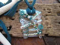 Wire+Wrapped+dichroic+glass+pendant+in+Turquoise+by+SilviaEngel