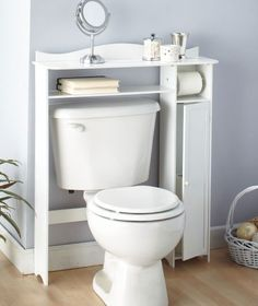 Over the toilet storage or this and then a wall mount over the toilet.