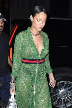 Showing some skin: Rihanna left very little to the imagination in a sheer lace dress as she stepped out in New York on Wednesday night