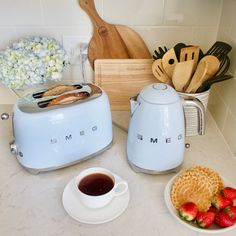 My Smeg kitchen appliances are in overdrive these days. I'm sharing my favorite retro kitchen appliances that are sophisticated and functional. Smeg Kitchen, Retro Kitchen Appliances, Kitchen Appliance Storage, Farmhouse Kitchen Cabinets, Kitchen Cabinet Design, Kitchen Backsplash, Kitchen Decor, Home Appliances, Kitchen Taps