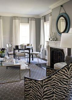 dining/living space - interesting variety of lines: zebra, geometric, circles, curves, squares, straight, arched....