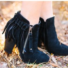 "Fall Fringe bootie Gorgeous faux suede fringe bootie. These are the Hottest bootie this season! Color: black Suede-like outside with fringe heel. Functional outer zipper.  Approx. 3.25"" heel stacked heel. Model wearing size 8. These are true to size. Will have size size 5.5, 8.5 Limited quantities will be available. TK1478110222101.  Will also be available in grey and beige soon! 2 a T Boutique  Shoes Ankle Boots & Booties"