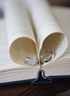 Photo Tip: Tuck two pages of a book to create a perfect heart shape. Photo by Maria Longhi Photography via Style Me Pretty