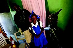 Altidor Jean Sergot prepares his 9 year old daughter for school in their new home. (UNDP)