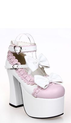 An impressive high raised sole platform lolita shoe in white and pastel pink.  The shoe has criss cross strap across the bridge decorated with bows and ankle strap finished with a large pink bow to the rear.  To complete this amazing shoe is a matching white bow to the toe.  - Wedge base measures 7cm and heel 12cm high.  - Handmade from PU leather.