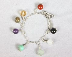 charm jewelry collection - stone-by-stone bracelet - Be a Wednesday Winner - http://earthwhorls.com/post/win-a-stone-by-stone-charm-bracelet/