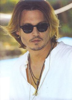 Johnny Depp. As much as I love his dark hair, he did look pretty hot w/this dark blonde.