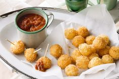 Crispy Bocconcini With Tomato Chilli Sauce Recipe - Creamy boccincini is golden fried for an enticing crunch, and served with a spicy tomato dip.