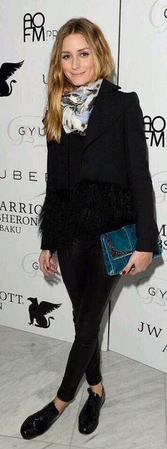 Who made Olivia Palermo's feather jacket, blue velvet clutch handbag, and leather pants?