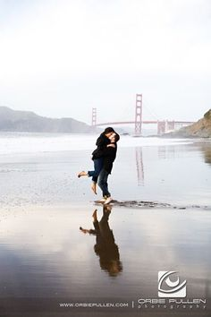 """LOVE the reflection in this one! """"Baker Beach Engagement and Wedding Photographer Orbie Pullen captured this photograph of a engaged couple in San Francisco, Ca."""""""