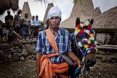 Soleman Ndara Pico, 29, a Pasola rider poses before heading to the main pasola field during the pasola war festival at Wainyapu village in Sumba Island, East Nusa Tenggara, Indonesia. Sandalwood pony horses are native to the island of Sumba in Indonesia. For the people of Sumba, the Sandelwood horse has an important role in all aspects of their daily life, including transportation and culture. On the island of Sumba the ancient tradition of Pasola still draws large crowds and tourists…