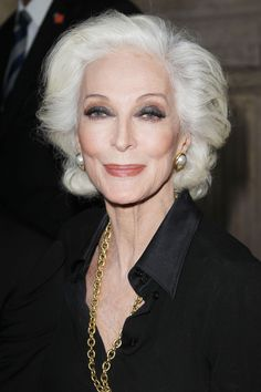 I am always intrigued by Carmen Dell'Orefice, who has been modeling for nearly 70 years. I see her regularly around my neighborhood, and she is never without a hair or lash out of place, even on the stormiest of days. Perfection.