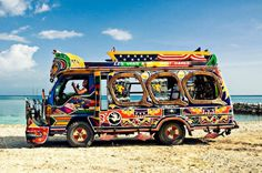 This is a tap-tap. Tap taps are elaborately painted buses or pick-up trucks that serve as share taxis in Haiti, and are renown for their paintings. These vehicles for hire are privately owned and beautifully decorated.They follow fixed routes and won't leave until filled with passengers, and riders can disembark at any point in the journey.     #TheHaitiTheyNeverShow